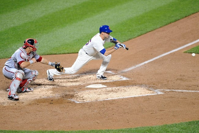 Sep 10, 2013; New York, NY, USA; New York Mets starting pitcher Dillon Gee (35) lays down a sacrifice bunt against the Washington Nationals at Citi Field. The Nationals won the game 6-3. Mandatory Credit: Joe Camporeale-USA TODAY Sports
