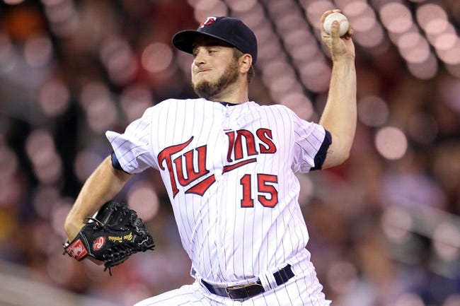 Sep 10, 2013; Minneapolis, MN, USA; Minnesota Twins pitcher Glen Perkins (15) delivers a pitch during the ninth inning against the Oakland Athletics at Target Field. The Twins won 4-3. Mandatory Credit: Brace Hemmelgarn-USA TODAY Sports