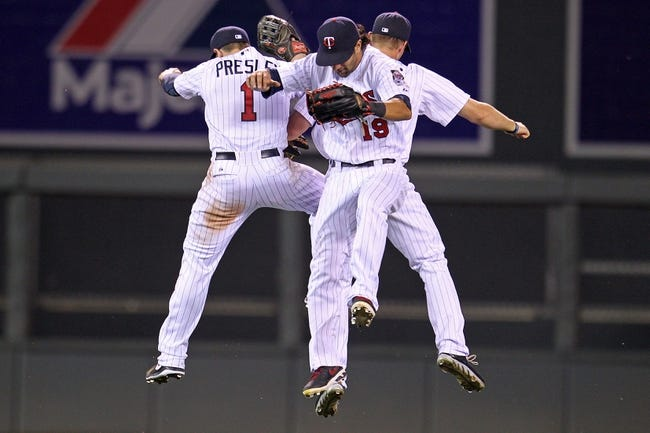 Sep 10, 2013; Minneapolis, MN, USA; Minnesota Twins outfielders Alex Presley (1), Darin Mastroianni (19), and Clete Thomas (11) celebrate after the game against the Oakland Athletics at Target Field. The Twins won 4-3. Mandatory Credit: Brace Hemmelgarn-USA TODAY Sports