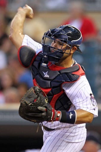 Sep 10, 2013; Minneapolis, MN, USA; Minnesota Twins catcher Josmil Pinto (43) throws during the first inning against the Oakland Athletics at Target Field. The Twins won 4-3. Mandatory Credit: Brace Hemmelgarn-USA TODAY Sports