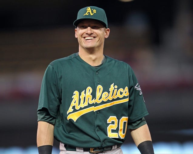 Sep 10, 2013; Minneapolis, MN, USA; Oakland Athletics third baseman Josh Donaldson (20) smiles during the second inning against the Minnesota Twins at Target Field. The Twins won 4-3. Mandatory Credit: Brace Hemmelgarn-USA TODAY Sports
