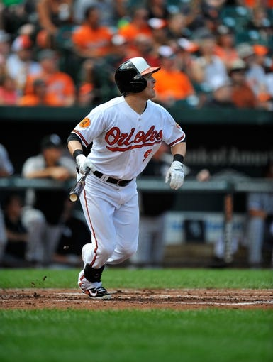 Sep 8, 2013; Baltimore, MD, USA; Baltimore Orioles left fielder Nate McLouth (9) bats in the first inning against the Chicago White Sox at Oriole Park at Camden Yards. The White Sox defeated the Orioles 4-2. Mandatory Credit: Joy R. Absalon-USA TODAY Sports