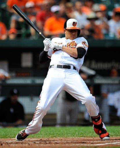 Sep 8, 2013; Baltimore, MD, USA; Baltimore Orioles third baseman Manny Machado (13) gets brushed back by a pitch in the first inning against the Chicago White Sox at Oriole Park at Camden Yards. The White Sox defeated the Orioles 4-2. Mandatory Credit: Joy R. Absalon-USA TODAY Sports