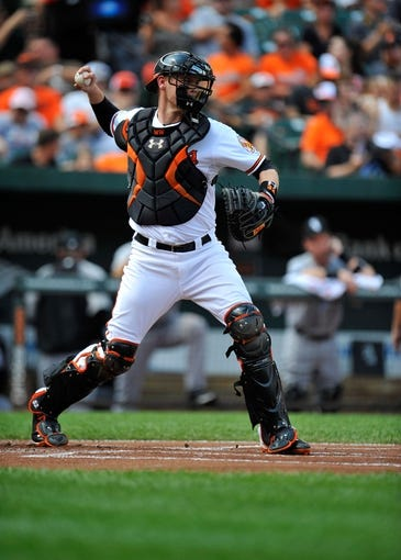 Sep 8, 2013; Baltimore, MD, USA; Baltimore Orioles catcher Matt Wieters (32) throws down to second base in the first inning against the Chicago White Sox at Oriole Park at Camden Yards. The White Sox defeated the Orioles 4-2. Mandatory Credit: Joy R. Absalon-USA TODAY Sports