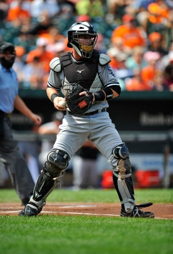 Sep 8, 2013; Baltimore, MD, USA; Chicago White Sox catcher Bryan Anderson (39) prepares to throw down to second base in the first inning against the Baltimore Orioles at Oriole Park at Camden Yards. The White Sox defeated the Orioles 4-2. Mandatory Credit: Joy R. Absalon-USA TODAY Sports