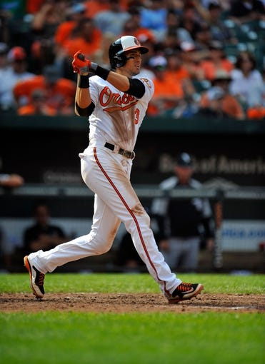 Sep 8, 2013; Baltimore, MD, USA; Baltimore Orioles second baseman Ryan Flaherty (3) bats in the seventh inning against the Chicago White Sox at Oriole Park at Camden Yards. The White Sox defeated the Orioles 4-2. Mandatory Credit: Joy R. Absalon-USA TODAY Sports