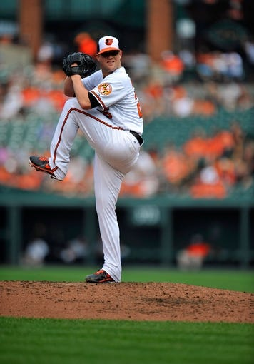 Sep 8, 2013; Baltimore, MD, USA; Baltimore Orioles starting pitcher Bud Norris (25) throws in the third inning against the Chicago White Sox at Oriole Park at Camden Yards. The White Sox defeated the Orioles 4-2. Mandatory Credit: Joy R. Absalon-USA TODAY Sports