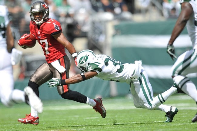 Sep 8, 2013; East Rutherford, NJ, USA; New York Jets defensive back Isaiah Trufant (35) makes a tackle on Tampa Bay Buccaneers wide receiver Eric Page (17) during the first half at MetLife Stadium. The Jets won 18-17. Mandatory Credit: Joe Camporeale-USA TODAY Sports