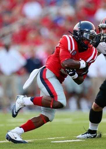 Sep 7, 2013; Oxford, MS, USA; Mississippi Rebels running back Jeff Scott (3) advances the ball for yardage during the game against the Southeast Missouri State Redhawks at Vaught-Hemingway Stadium. Mississippi Rebels defeated the Southeast Missouri State Redhawks 31-13.  Mandatory Credit: Spruce Derden-USA TODAY Sports