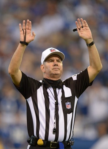 Sep 8, 2013; Indianapolis, IN, USA; NFL referee Bill Vinovich during the game between the Oakland Raiders and the Indianapolis Colts at Lucas Oil Stadium. Mandatory Credit: Kirby Lee-USA TODAY Sports