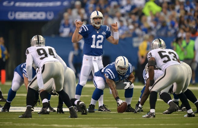 Sep 8, 2013; Indianapolis, IN, USA; Indianapolis Colts quarterback Andrew Luck (12) calls an audible against the Oakland Raiders at Lucas Oil Stadium. The Colts defeated the Raiders 21-17. Mandatory Credit: Kirby Lee-USA TODAY Sports
