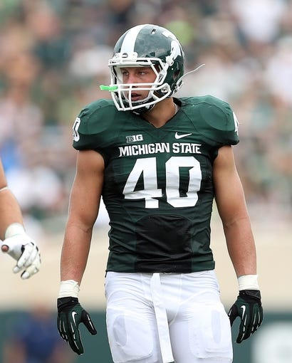Sep 7, 2013; East Lansing, MI, USA; Michigan State Spartans linebacker Max Bullough (40) looks to sideline for the play against the South Florida Bulls during the first quarter at Spartan Stadium. Mandatory Credit: Mike Carter-USA TODAY Sports