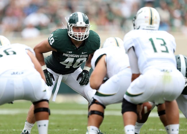 Sep 7, 2013; East Lansing, MI, USA; Michigan State Spartans linebacker Max Bullough (40) looks over South Florida Bulls offense during the 2nd half at Spartan Stadium. MSU won 21-6. Mandatory Credit: Mike Carter-USA TODAY Sports