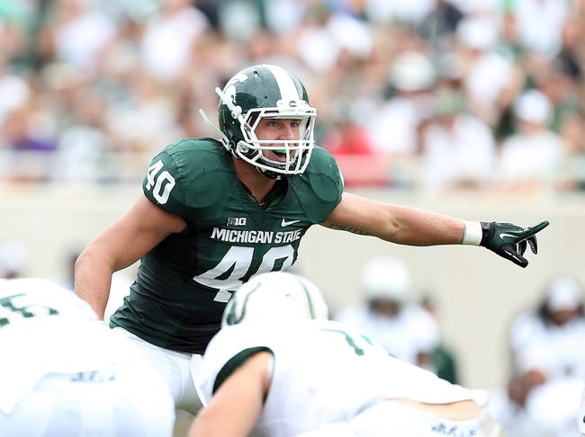 Sep 7, 2013; East Lansing, MI, USA; Michigan State Spartans linebacker Max Bullough (40) prepares for the snap of the ball during the 2nd half of a game between the Michigan State Spartans and the South Florida Bulls at Spartan Stadium. MSU won 21-6. Mandatory Credit: Mike Carter-USA TODAY Sports