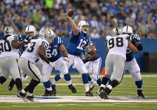 Sep 8, 2013; Indianapolis, IN, USA; Indianapolis Colts quarterback Andrew Luck (12) throws a pass against the Oakland Raiders at Lucas Oil Stadium. The Colts defeated the Raiders 21-17. Mandatory Credit: Kirby Lee-USA TODAY Sports