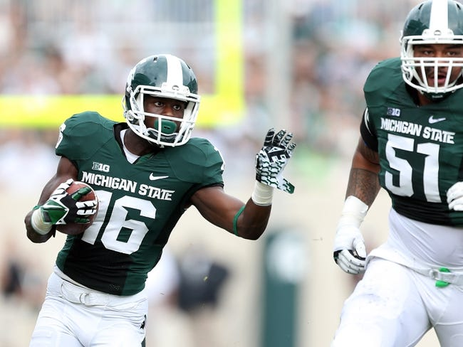 Sep 7, 2013; East Lansing, MI, USA; Michigan State Spartans wide receiver Aaron Burbridge (16) runs the ball after the catch against the South Florida Bulls during the first half at Spartan Stadium. Mandatory Credit: Mike Carter-USA TODAY Sports