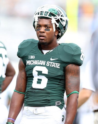 Sep 7, 2013; East Lansing, MI, USA; Michigan State Spartans cornerback Mylan Hicks (6) on sidelines prior to a game against the South Florida Bulls  at Spartan Stadium. Mandatory Credit: Mike Carter-USA TODAY Sports