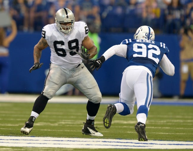 Sep 8, 2013; Indianapolis, IN, USA; Oakland Raiders tackle Khalif Barnes (69) defends against Indianapolis Colts linebacker Bjoern Werner (92) at Lucas Oil Stadium. The Colts defeated the Raiders 21-17. Mandatory Credit: Kirby Lee-USA TODAY Sports