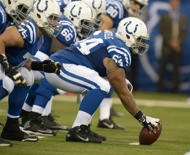 Sep 8, 2013; Indianapolis, IN, USA; Indianapolis Colts center Samson Satele (64) snaps the ball against the Oakland Raiders at Lucas Oil Stadium. The Colts defeated the Raiders 21-17. Mandatory Credit: Kirby Lee-USA TODAY Sports