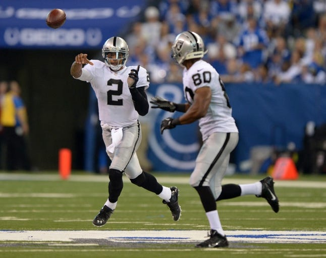 Sep 8, 2013; Indianapolis, IN, USA; Oakland Raiders quarterback Terrelle Pryor (2) throws a pass to receiver Rod Streater (80) during the game against the Indianapolis Colts at Lucas Oil Stadium. The Colts defeated the Raiders 21-17. Mandatory Credit: Kirby Lee-USA TODAY Sports