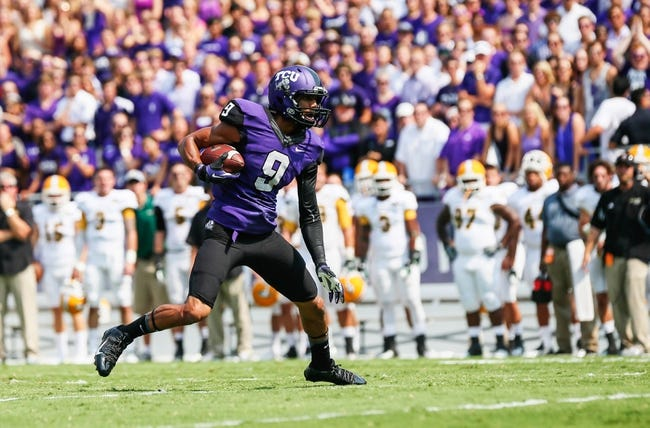 Sep 7, 2013; Fort Worth, TX, USA; TCU Horned Frogs wide receiver Josh Doctson (9) runs with the ball during the game against the Southeastern Louisiana Lions at Amon G. Carter Stadium. Mandatory Credit: Kevin Jairaj-USA TODAY Sports