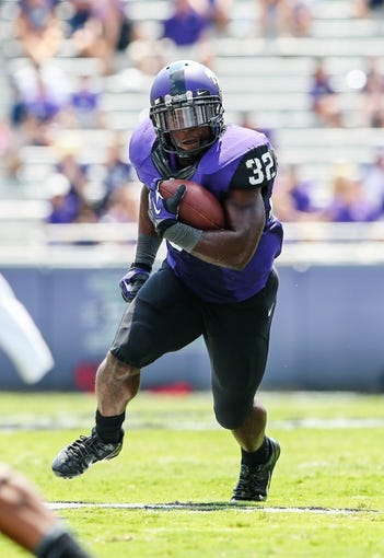 Sep 7, 2013; Fort Worth, TX, USA; TCU Horned Frogs running back Waymon James (32) runs with the ball during the game against the Southeastern Louisiana Lions at Amon G. Carter Stadium. Mandatory Credit: Kevin Jairaj-USA TODAY Sports
