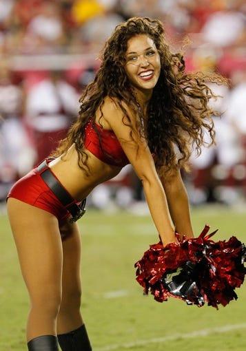 Aug 29, 2013; Tampa, FL, USA; Tampa Bay Buccaneers cheerleader during the first half against the Washington Redskins at Raymond James Stadium. Mandatory Credit: Kim Klement-USA TODAY Sports