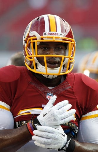 Aug 29, 2013; Tampa, FL, USA; Washington Redskins defensive back Chase Minnifield (25) works out prior to the game against the Tampa Bay Buccaneers at Raymond James Stadium. Mandatory Credit: Kim Klement-USA TODAY Sports