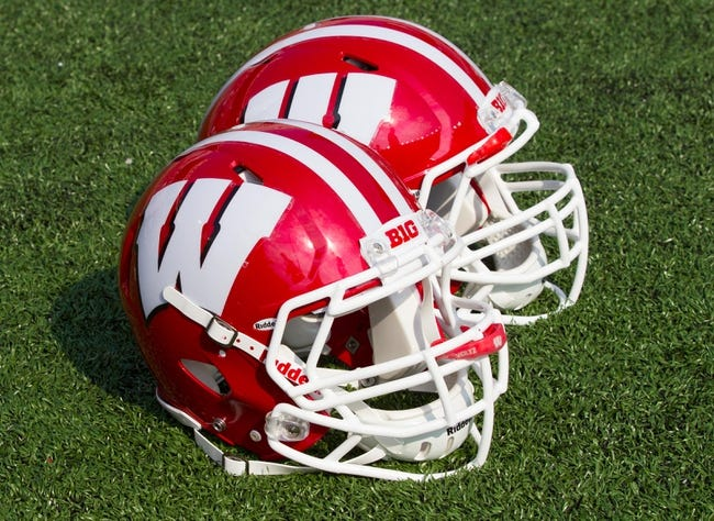 Sep 7, 2013; Madison, WI, USA; Wisconsin Badgers helmets sit on the field during warmups prior to the game against the Tennessee Tech Golden Eagles at Camp Randall Stadium.  Wisconsin won 48-0.  Mandatory Credit: Jeff Hanisch-USA TODAY Sports