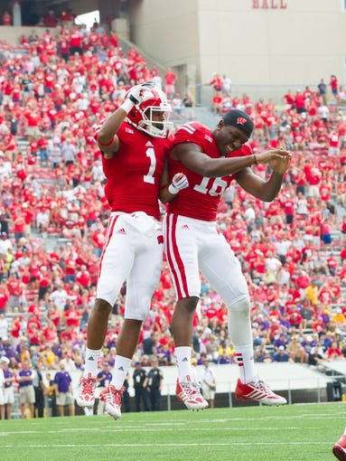 Sep 7, 2013; Madison, WI, USA; Wisconsin Badgers wide receiver A.J. Jordan (1) and wide receiver Reggie Love (16) celebrate during the game against the Tennessee Tech Golden Eagles at Camp Randall Stadium.  Wisconsin won 48-0.  Mandatory Credit: Jeff Hanisch-USA TODAY Sports