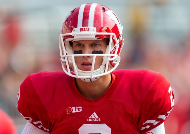 Sep 7, 2013; Madison, WI, USA; Wisconsin Badgers quarterback Joel Stave (2) during warmups prior to the game against the Tennessee Tech Golden Eagles at Camp Randall Stadium.  Wisconsin won 48-0.  Mandatory Credit: Jeff Hanisch-USA TODAY Sports
