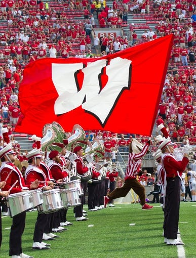 Sep 7, 2013; Madison, WI, USA; Wisconsin Badgers mascot Bucky Badger carries the Wisconsin flag prior to the game against the Tennessee Tech Golden Eagles at Camp Randall Stadium.  Wisconsin won 48-0.  Mandatory Credit: Jeff Hanisch-USA TODAY Sports