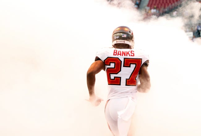 Aug 29, 2013; Tampa, FL, USA; Tampa Bay Buccaneers cornerback Johnthan Banks (27) runs out of the tunnel prior to the game against the Washington Redskins at Raymond James Stadium. Mandatory Credit: Kim Klement-USA TODAY Sports
