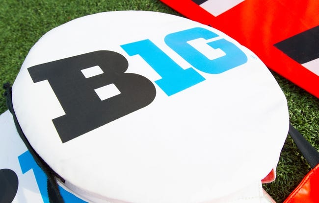 Sep 7, 2013; Madison, WI, USA; The Big 10 Logo atop yardage markers during warmups prior to the game between the Tennessee Tech Golden Eagles and Wisconsin Badgers at Camp Randall Stadium.  Wisconsin won 48-0.  Mandatory Credit: Jeff Hanisch-USA TODAY Sports