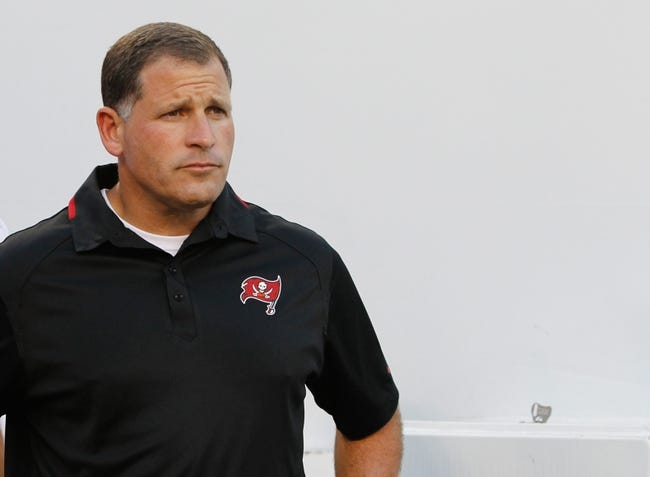 Aug 29, 2013; Tampa, FL, USA; Tampa Bay Buccaneers head coach Greg Schiano gets ready to run out of the tunnel before the game against the Washington Redskins at Raymond James Stadium. Mandatory Credit: Kim Klement-USA TODAY Sports