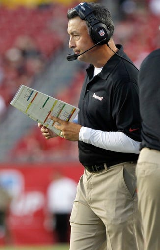 Aug 29, 2013; Tampa, FL, USA; Tampa Bay Buccaneers offensive coordinator Mike Sullivan calls a play during the first quarter against the Washington Redskins at Raymond James Stadium. Mandatory Credit: Kim Klement-USA TODAY Sports