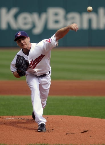 Sep 11, 2013; Cleveland, OH, USA; Cleveland Indians starting pitcher Scott Kazmir (26) pitches against the Kansas City Royals during the first inning at Progressive Field. Mandatory Credit: Ken Blaze-USA TODAY Sports