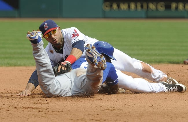 Sep 11, 2013; Cleveland, OH, USA; Cleveland Indians shortstop Mike Aviles (4) tries to pick off Kansas City Royals center fielder Lorenzo Cain (6) at second during the fourth inning at Progressive Field. Mandatory Credit: Ken Blaze-USA TODAY Sports