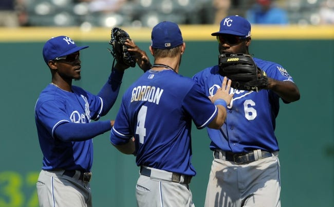 Sep 11, 2013; Cleveland, OH, USA; Kansas City Royals player Jarrod Dyson (1), left fielder Alex Gordon (4) and center fielder Lorenzo Cain (6) celebrate the Royals 6-2 win over the Cleveland Indians at Progressive Field. Mandatory Credit: Ken Blaze-USA TODAY Sports