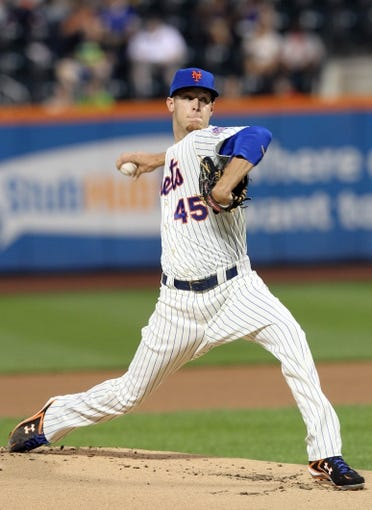 Sep 11, 2013; New York, NY, USA; New York Mets starting pitcher Zack Wheeler (45) pitches against the Washington Nationals during the first inning of a game at Citi Field. Mandatory Credit: Brad Penner-USA TODAY Sports