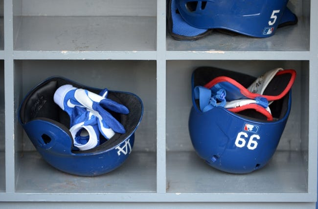 Sep 11, 2013; Los Angeles, CA, USA; General view of Los Angeles Dodgers helmets of Juan Uribe (not pictured) and Yasiel Puig (not pictured) before the game against the Arizona Diamondbacks at Dodger Stadium. Mandatory Credit: Kirby Lee-USA TODAY Sports