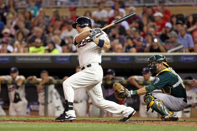 Sep 11, 2013; Minneapolis, MN, USA; Minnesota Twins left fielder Josh Willingham (16) hits a single in the second inning against the Oakland Athletics at Target Field. Mandatory Credit: Jesse Johnson-USA TODAY Sports