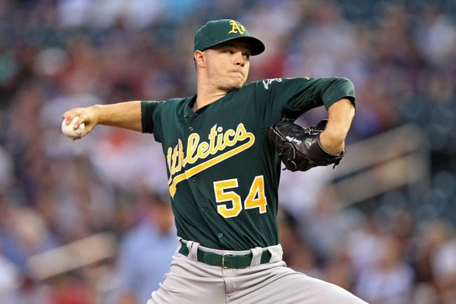 Sep 11, 2013; Minneapolis, MN, USA; Oakland Athletics starting pitcher Sonny Gray (54) delivers a pitch in the first inning against the Minnesota Twins at Target Field. Mandatory Credit: Jesse Johnson-USA TODAY Sports