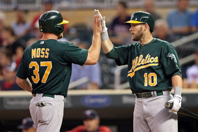 Sep 11, 2013; Minneapolis, MN, USA; Oakland Athletics right fielder Brandon Moss (37) celebrates with first baseman Daric Barton (10) after scoring a run in the second inning against the Minnesota Twins at Target Field. Mandatory Credit: Jesse Johnson-USA TODAY Sports