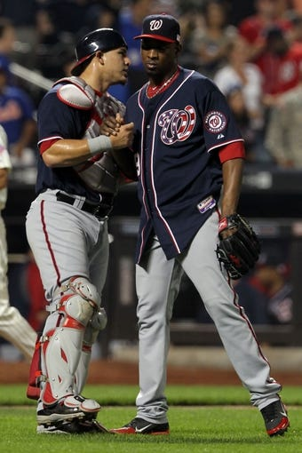 Sep 11, 2013; New York, NY, USA; Washington Nationals relief pitcher Rafael Soriano (29) and Washington Nationals catcher Wilson Ramos (40) celebrate a win over the New York Mets following a game at Citi Field. Mandatory Credit: Brad Penner-USA TODAY Sports