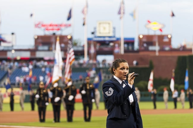 Sep 11, 2013; Philadelphia, PA, USA; USAF TSGT Karen Blackburn sings America the Beautiful prior to the game between the Philadelphia Phillies and the San Diego Padres at Citizens Bank Park. The Phillies defeated the Padres 4-2. Mandatory Credit: Howard Smith-USA TODAY Sports