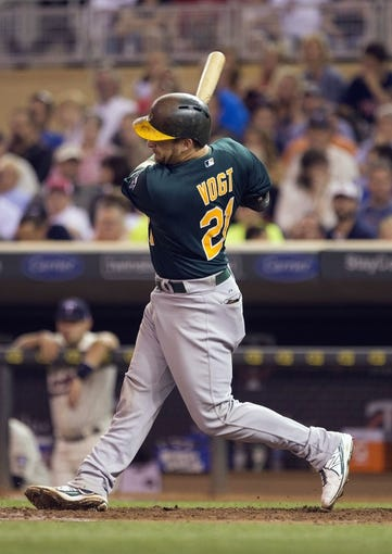 Sep 11, 2013; Minneapolis, MN, USA; Oakland Athletics catcher Stephen Vogt (21) hits a RBI single in the fourth inning against the Minnesota Twins at Target Field. Mandatory Credit: Jesse Johnson-USA TODAY Sports