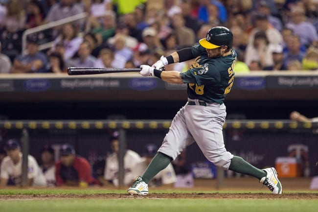 Sep 11, 2013; Minneapolis, MN, USA; Oakland Athletics second baseman Eric Sogard (28) hits a RBI single in the fourth inning against the Minnesota Twins at Target Field. Mandatory Credit: Jesse Johnson-USA TODAY Sports