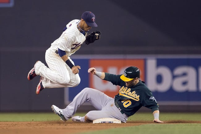 Sep 11, 2013; Minneapolis, MN, USA; Minnesota Twins shortstop Pedro Florimon (25) forces out Oakland Athletics first baseman Daric Barton (10) at second base in the fourth inning at Target Field. Mandatory Credit: Jesse Johnson-USA TODAY Sports