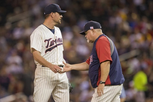 Sep 11, 2013; Minneapolis, MN, USA; Minnesota Twins manager Ron Gardenhire pulls starting pitcher Mike Pelfrey (37) from the game in the fourth inning against the Oakland Athletics at Target Field. Mandatory Credit: Jesse Johnson-USA TODAY Sports
